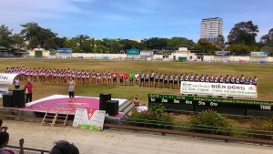 Catherine Schmitz from the Australian Consulate singing the National Anthem