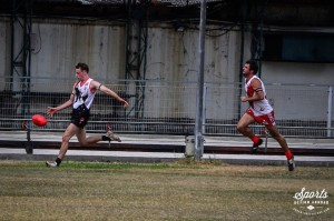 Joe Vile twisting the footy onto the checkside for a memorable ANZAC goal (Photo: www.adventurefaktory.com)